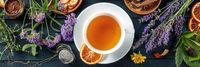 Organic tea panorama, overhead flat lay shot. Herbs, flowers and fruit