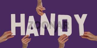 White alphabet lettering spelling HANDY