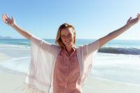 Caucasian woman enjoying time on the beach
