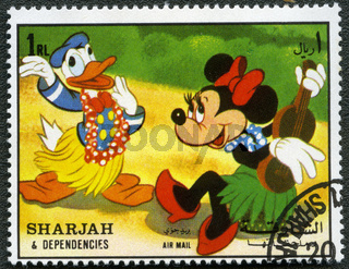 SHARJAH  DEPENDENCIES - CIRCA 1972: devoted fifty years of Walt Disney cartoon characters, shows Donald Duck and Minnie