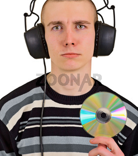 Sad disappointed man with big headphones and CD