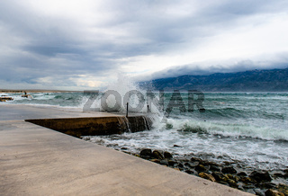 Dark sky with clouds and stormy waves in the sea