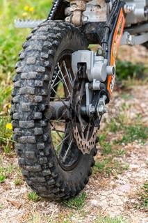 mini motocross detail of the braking part and rear wheel