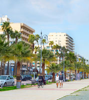 People walking embankment Larnaca Cyprus