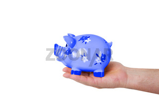 Hand holding piggy bank