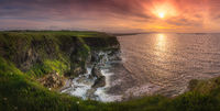 Wide panorama with beautiful white, limestone cliffs at dramatic sunset