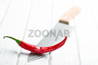 chili pepper on knife