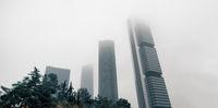 Four Towers Business Area against misty sky. Madrid, Spain