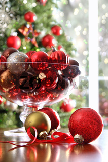 Red Christmas balls on table