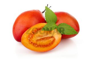 Sliced ripe Tamarillo fruits isolated on white