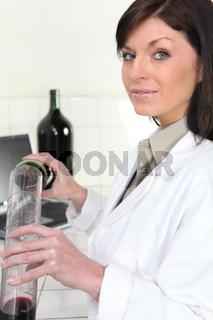 Woman oenologist in laboratory