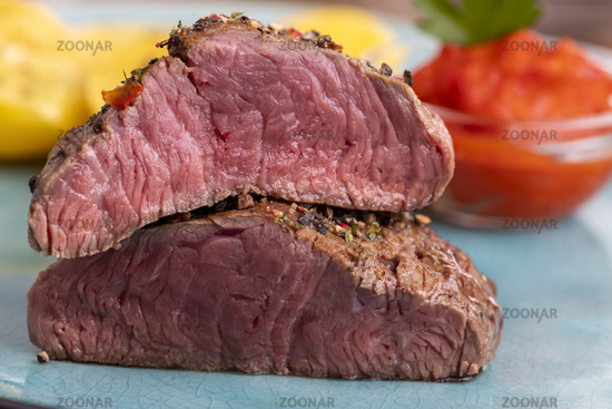 Pepper steak on a blue plate