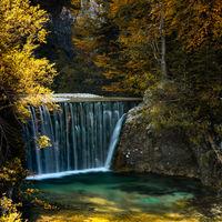 view of the Pisnica Waterfall near Kranjska Gora in the Julian Alps of Slovenia in late autumn