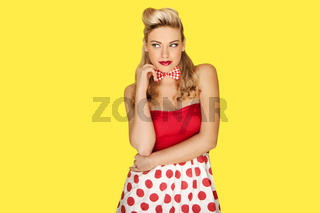 Retro fashion model in red polka dots