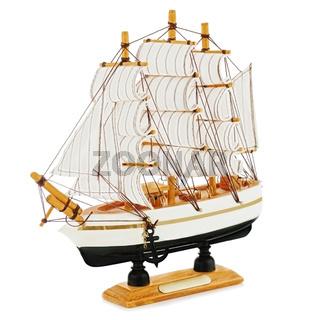 Old sailboat model isolated on white background.