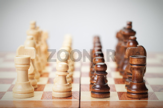 chess board with figures on grey background