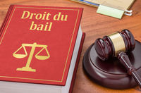 A law book with a gavel - Tenancy Law in french - Droit du bail
