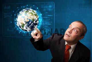 Businessman touching high-tech 3d earth panel