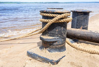 Mooring bollard with a fixed rope in the harbor