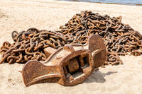 Rusty anchor chain with ship anchor of an old ship