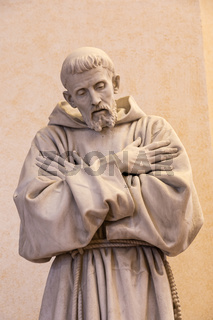 Assisi village in Umbria region, Italy. Statue of St. Francis. The town is famous for the most important Italian Basilica dedicated to St. Francis - San Francesco.