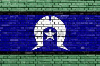 flag of Torres Strait Islanders painted on brick wall