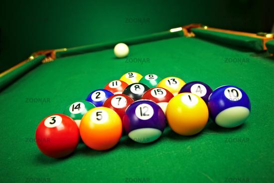 billiard balls on green cloth
