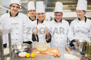 Culinary class with pastry teacher giving thumbs up