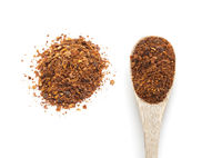 Ground red chili pepper paprika spice in wooden spoon
