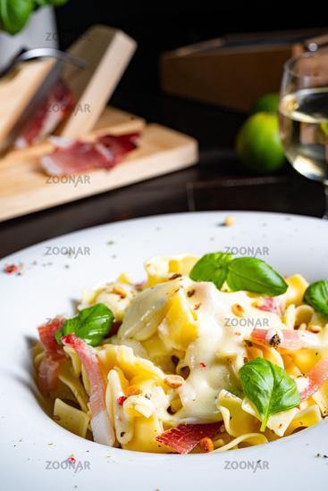 Tagliatelle with gorgonzola masarpone sauce and ham.