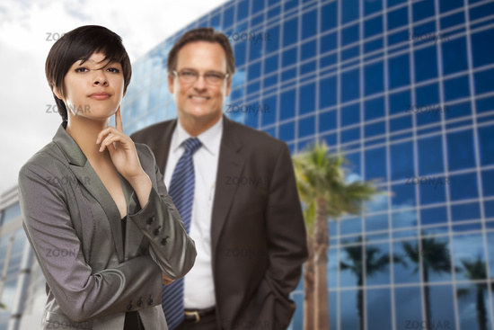 Woman and Businessman in Front of Building