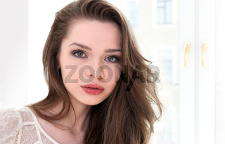 Face of the beautiful woman with brown hair