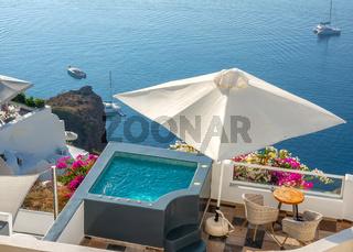 Sunny Terraces With a Swimming Pool on the Mountainous Coast of Santorini