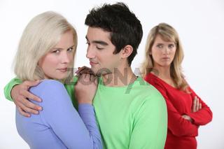 Woman jealous of couple hugging
