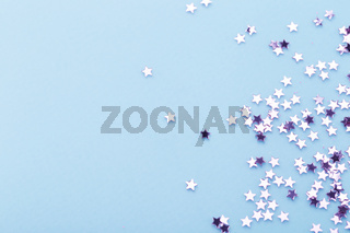 Purple stars on blue background