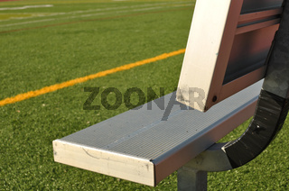 Bench on the Sideline of a Football Field