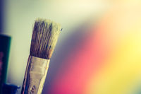 Painting artwork: paint brushes on creative background