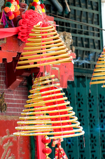 A view of hanging incense coils in temple