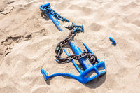 Old anchor ship  with anchor chain on the sand