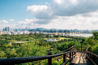 Panoramic view of Seoul city and green forest from Sky park in Korea