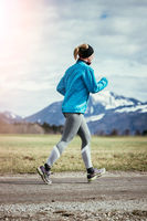 Sporty young woman is jogging in nature