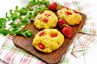 Scones with strawberry on board
