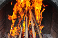 Garden barbecue fire with wood