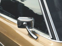 Sideview mirror of an old vintage car,
