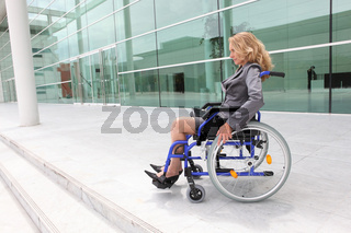 Woman in a wheelchair outside an office building