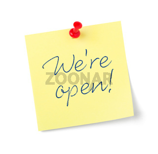 Yellow paper note with text  We are open