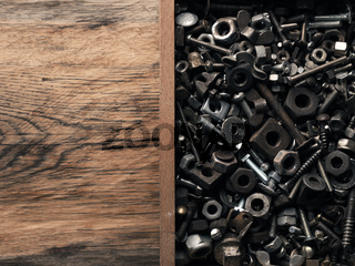 Rusty old bolts and nuts in a wooden box