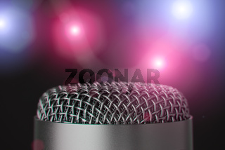 Closeup of microphone with colorful bright lights