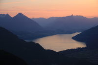 Red evening sky over Lake Thun and mountain ranges in Switzerland.