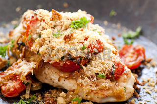 chicken steak with baked parmesan and tomatos